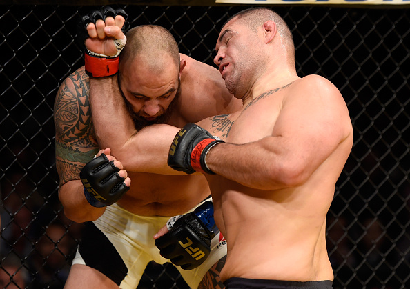 LAS VEGAS, NV - JULY 09: (R-L) Cain Velasquez punches Travis Browne in their heavyweight bout during the UFC 200 event on July 9, 2016 at T-Mobile Arena in Las Vegas, Nevada. (Photo by Josh Hedges/Zuffa LLC/Zuffa LLC via Getty Images)