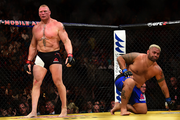 LAS VEGAS, NV - JULY 09: (L-R) Brock Lesnar and Mark Hunt of New Zealand return to their corners after round one in their heavyweight bout during the UFC 200 event on July 9, 2016 at T-Mobile Arena in Las Vegas, Nevada. (Photo by Harry How/Zuffa LLC/Zuffa LLC via Getty Images)