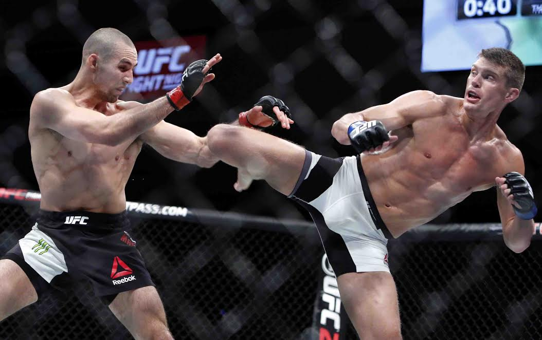 Stephen Thompson, right, kicks to the body of Rory MacDonald during UFC welterweight bout in Ottawa on Saturday June 18, 2016. Thompson won a unanimous decision over MacDonald in a battle of top welterweight contenders at UFC Fight Night 89 Saturday night. THE CANADIAN PRESS/Fred Chartrand